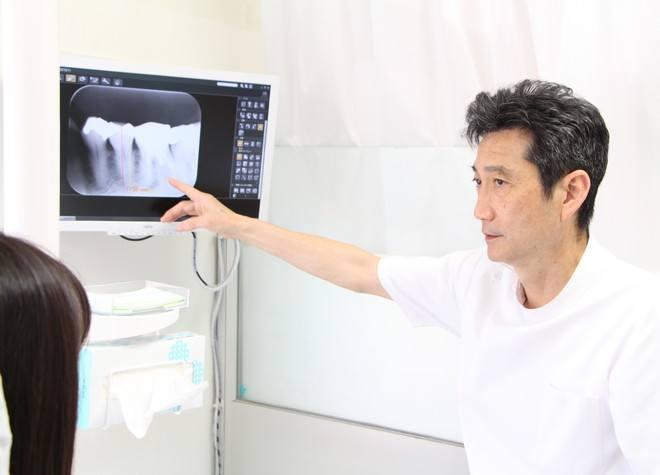 畑歯科医院 清瀬市 院長による治療説明の写真